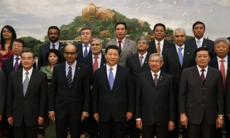 China's President Xi Jinping (front C) poses for photos with guests at the Asian Infrastructure Investment Bank launch ceremony at the Great Hall of the People in Beijing, October 24, 2014. /REUTERS
