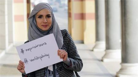 On February 1, for World Hijab Day, hijab-wearing activists posted photos of themselves holding signs with the hashtag #unbiased [Al Jazeera]